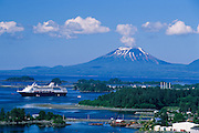 Alaska. Sitka. Cruise ship with Mt Edgecumbe in the distance.