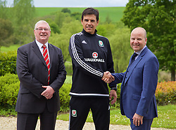 CARDIFF, WALES - Monday, May 23, 2016: FAW President David Griffith [L] and Chief-Executive Jonathan Ford [R] with national team manager Chris Coleman after agreeing a contract extension until the end of the 2018 World Cup Qualifying campaign, announced during a press conference at the Vale Resort Hotel. (Pic by David Rawcliffe/Propaganda)