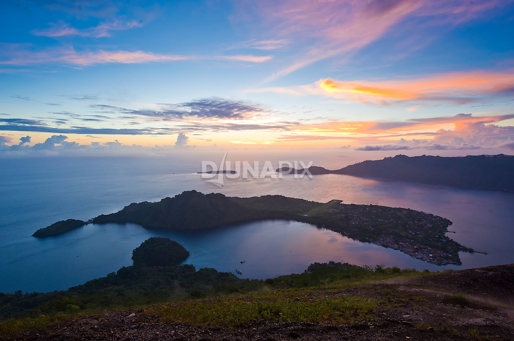 Sunrise view of Banda Neira Island from the summit of Gunung Api Volcano, Banda Islands, Indonesia.