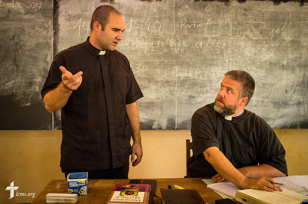 The Rev. Jacob Gaugert and the Rev. Micah Wildauer, LCMS missionaries to Togo, talk together during an exam at the Lutheran Center for Theological Studies (CLET) on Wednesday, Feb. 15, 2017, in Dapaong, Togo. LCMS Communications/Erik M. Lunsford