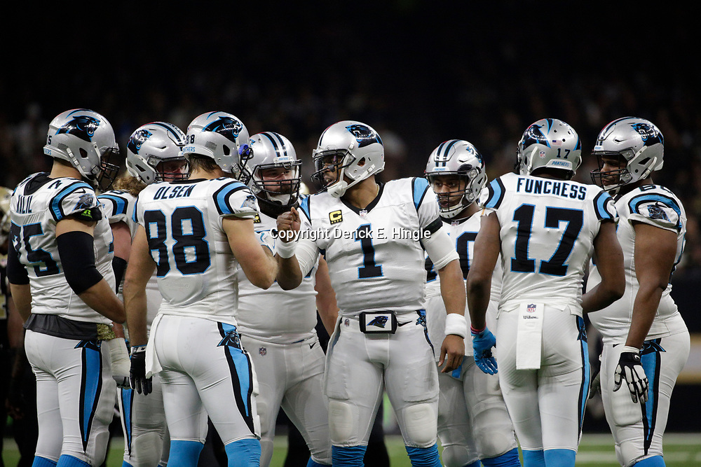 Jan 7, 2018; New Orleans, LA, USA; Carolina Panthers quarterback Cam Newton (1) talks to his teammates  during the first quarter in the NFC Wild Card playoff football game against the New Orleans Saints at Mercedes-Benz Superdome. Mandatory Credit: Derick E. Hingle-USA TODAY Sports