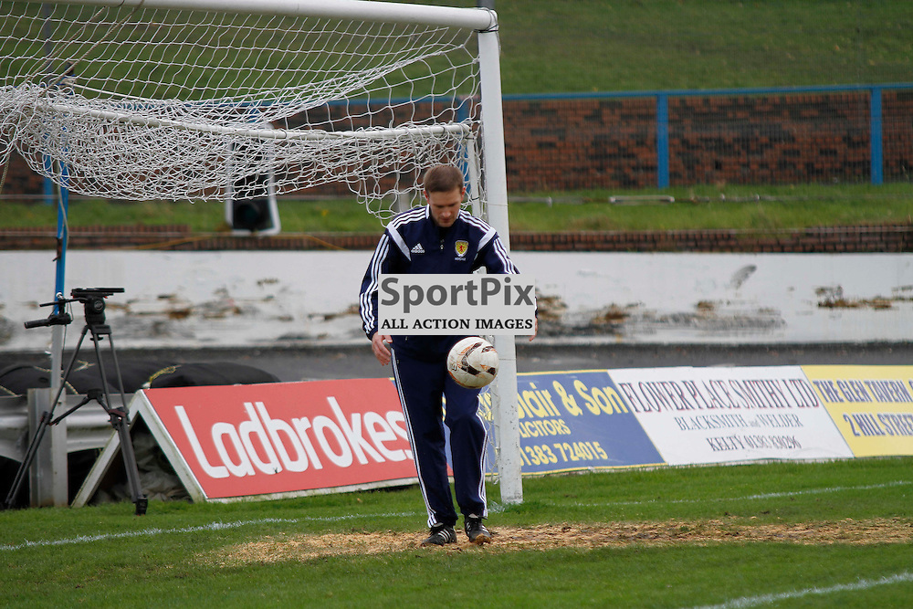 Pictured. Referee Gavin Ross tests the bounce of the ball in the goalmouth during an 11am inspection at Central Park, which is not known for drainage problems. The ground-staff drained the area at 8am and added sand to help the playing surface pass the inspection. <br /> <br /> Cowdenbeath FC V Brechin FC, Scottish League 1, 14th November 2015Cowdenbeath FC V Brechin FC, Scottish League 1, 14th November 2015Cowdenbeath FC V Brechin FC, Scottish League 1, 14th November 2015