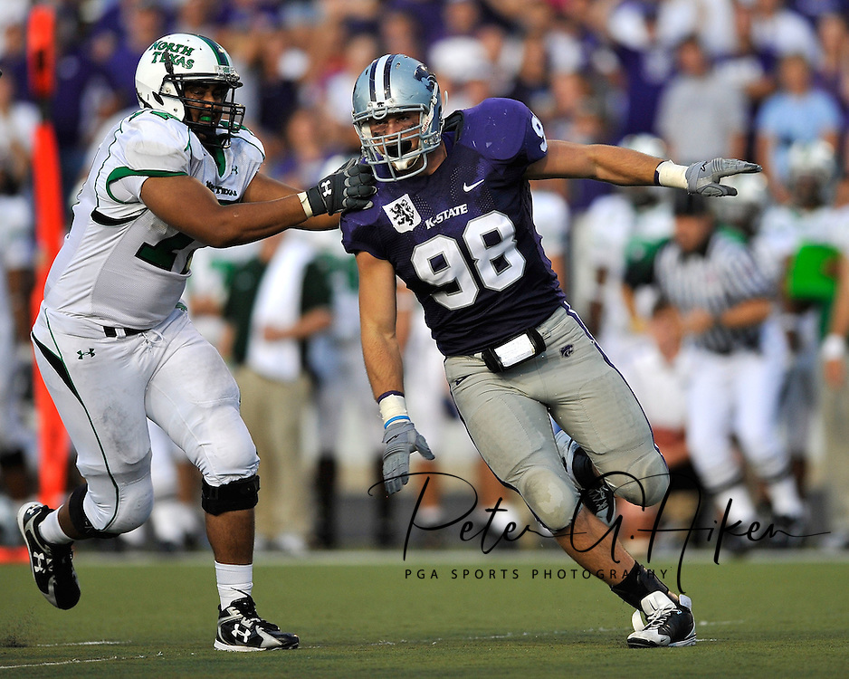 MANHATTAN, KS - AUGUST 30:  MANHATTAN, KS - August 30:  Defensive end Ian Campbell #98 of the Kansas State Wildcats moves around a block from right tackle Esteban Santiago #77 of the North Texas Mean Green in the second quarter on August 30, 2008 at Bill Snyder Family Stadium in Manhattan, Kansas.