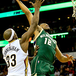 Nov 1, 2016; New Orleans, LA, USA; Milwaukee Bucks forward Jabari Parker (12) dunks over New Orleans Pelicans forward Dante Cunningham (33) during the second quarter of a game at the Smoothie King Center. Mandatory Credit: Derick E. Hingle-USA TODAY Sports