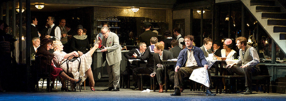 La Boheme<br /> by Giacomo Puccini <br /> translation by Amanda Holden <br /> conductor Gianluca Marciano<br /> directed by Jonathan Miller<br /> revival director Natascha Metherell<br /> <br /> at the London Coliseum, London, Great Britain <br /> rehearsal <br /> 27th October 2014 <br /> <br /> George von Bergen as Marcello <br /> <br /> David Butt Philip as Rodolfo <br /> <br /> Barnaby Rea as Colline <br /> <br /> George Humphreys as Schaunard <br /> <br /> Andrew Shore as Benoit <br /> <br /> Angel Blue as Mimi <br /> <br /> Philip Daggett as Parpignol <br /> <br /> Jennifer Holloway as Musetta<br /> <br /> Andrew Shore as Alcindoro<br /> <br /> Paul Sheehan as Policeman <br /> <br /> Andrew Tinkler as Foreman <br /> <br /> includes actors:<br /> <br /> Tom Fackrell<br /> Elizabeth George<br /> Irene Hardy <br /> Andrew Hayler<br /> David John <br /> Anthony Kurt-Gabel<br /> <br /> Photograph by Elliott Franks