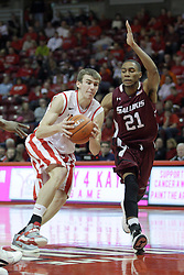 02 February 2013:  Jon Ekey heads for the hoop defended by Josh Swan during an NCAA Missouri Valley Conference mens basketball game where the Salukis of Southern Illinois lost to the Illinois State Redbirds for Retro-Night 83-47 in Redbird Arena, Normal IL