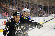 Dallas Stars left wing Eric Nystrom (24) chases down a loose puck against St. Louis Blues defenseman Alex Pietrangelo (27) in the Stars 4-3 loss at the American Airlines Center in Dallas, Texas, on January 26, 2013.  (Stan Olszewski/The Dallas Morning News)