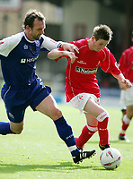 Photo:  Frances Leader.<br /> Swindon Town FC v Peterborough Utd.  Coca-Cola football league one.<br /> The County Ground.<br /> 11/09/2004<br /> Peterborough's Steve Jenkins and Swindon's Grant Smith.