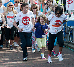 Richard Hammond and Dame Kelly Holmes taking part in a one mile run for Sport Relief charity in London, 25th March 2012.  Photo by: i-Images