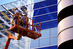 Stock photo of workmen on a lift during new construction at George R. Brown Convention Center in Houston, Texas