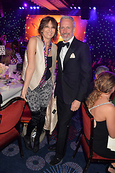 CHRISSIE HYNDES and PATRICK COX at the Caudwell Children's annual Butterfly Ball held at The Grosvenor House Hotel, Park Lane, London on 15th May 2014.