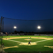 Night falls on Municipal Stadium in Clarinda during a late June tournament game.  photo by David Peterson
