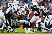 NASHVILLE, TN - NOVEMBER 29:  Latavius Murray #28 of the Oakland Raiders runs the ball and is tackled by Avery Williamson #54 and Jurrell Casey #99 of the Tennessee Titans at Nissan Stadium on November 29, 2015 in Nashville, Tennessee.  The Raiders defeated the Titans 24-21.  (Photo by Wesley Hitt/Getty Images) *** Local Caption *** Latavius Murray; Avery Williamson; Jurrell Casey