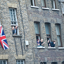 London, UK - 17 April 2013: londoners watch the parade out of windows during Margaret Thatcher funeral in London