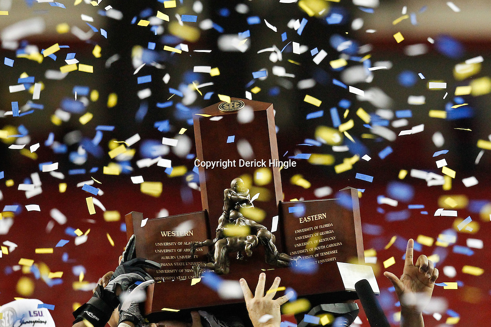 Dec 3, 2011; Atlanta, GA, USA; LSU players hold up the SEC championship trophy following a win over the Georgia Bulldogs in the 2011 SEC championship game at the Georgia Dome.  Mandatory Credit: Derick E. Hingle-US PRESSWIRE
