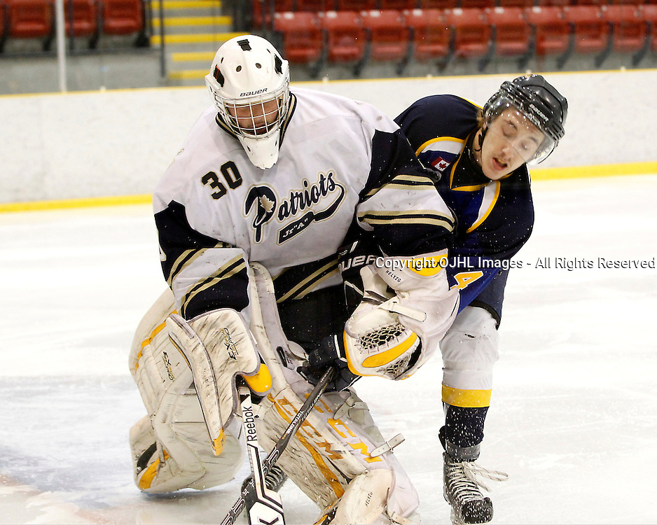 WELLINGTON, ON - Apr 30 : Dudley Hewitt Cup, Central Canadian Jr &quot;A&quot; Championship. Jeremy Helvig #30 of the Toronto Lakeshore Patriots battles for the puck with Tanner Lafrance #4 of the Kirkland Lake Gold Miners.<br /> (Photo by Tim Bates / OJHL Images)