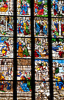 Milan, Italy, Duomo Cathedral. Stained glass window depicting a story in many panes.