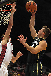 Colorado guard Thomas Akyazili (0) shoots over Stanford forward Michael Humphrey during the first half of an NCAA college basketball game in Stanford, Calif., Sunday, Jan. 3, 2016. Colorado won 56-55. (AP Photo/Jason O. Watson)
