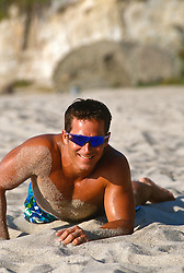 Man in sunglasses lying on the beach