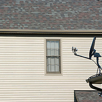 Satellite dish on roof of house, Plainfield, Illinois, USA