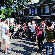 Tourists pose for photos at the marker of the Prime Meridian of the world at the Royal Observatory, Greenwich