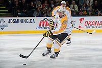 KELOWNA, CANADA - OCTOBER 25: Colton Waltz #5 of Brandon Wheat Kings skates with the puck against the Kelowna Rockets on October 25, 2014 at Prospera Place in Kelowna, British Columbia, Canada.  (Photo by Marissa Baecker/Shoot the Breeze)  *** Local Caption *** Colton Waltz;