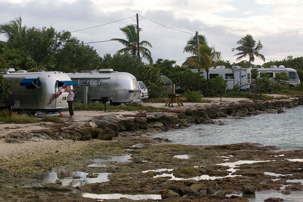 "FREE_KeysStateParks..Caption:( 12/05/2009)Linda McKeand decorates her Airstream trailer at Bahia Honda State Park. McKeand and her husband Brian, originally of Calif. moved to Florida about a year ago and say that Bahia Honda is their favorite state park in the Keys. ""This is it!"" says Brian McKeand. They love it because of the view and because it offers both ocean and gulf beaches. The Florida Keys offer several options for adventure, camping and sightseeing at State Parks...Summary:Florida Keys State Parks...Photo by James Branaman"