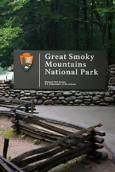 National Park Service welcome sign to Great Smoky Mountains National Park, in front of split rail fence, Tennessee, July 8, 2008
