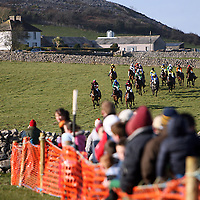 Horses and jockey's make their way down the hill in the 3rd at the annual Bellhabour point to point on Sunday.<br /> Photograph by Yvonne Vaughan