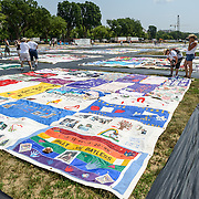 Aids Memorial Quilt on the National Mall. Part of the Aids Memorial Quilt by the Names Project Foundation laid out on the National Mall as part of the Smithsonian Folklife Festival in Washington DC. The quilt memorializes those who have died of Aids and Aids-related illnesses.