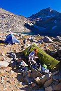 Climber in camp at Dade Lake under Bear Creek Spire, John Muir Wilderness, Sierra Nevada Mountains, California