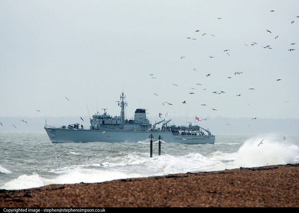 © Licensed to London News Pictures. 11/11/2014. Southsea, UK. A navy ship leaves port. Wet and windy weather today, 11 November 2014, at Southsea, Portsmouth. The Met Office have issued weather warnings in some parts of the UK. Photo credit : Stephen Simpson/LNP