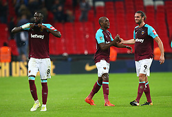 October 25, 2017 - London, England, United Kingdom - L-R West Ham United's Andre Ayew and West Ham United's Andy Carroll celebratee they win.during Carabao Cup 4th Round match between Tottenham Hotspur and West Ham United at Wembley Stadium, London,  England on 25 Oct  2017. (Credit Image: © Kieran Galvin/NurPhoto via ZUMA Press)