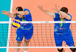 Mitja Gasparini #6 of Slovenia and Matevz Kamnik #7 of Slovenia during qualifications match of FIVB Men's Volleyball World Championship 2014 between National teams of Slovenia and Hungary in pool B on May 25, 2013 in Arena Stozice, Ljubljana, Slovenia. Slovenia defeated Hungary 3-0. (Photo By Vid Ponikvar / Sportida)
