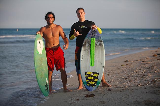 4/1/13---Miami Beach, Florida---Photo by Angel Valentin<br /> Jose Gabriel, left, and Martin Farkas take a break from skim boarding in Miami Beach.