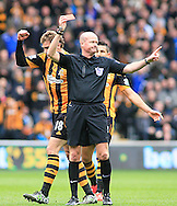 Ref M Mason shows the red card to Vincent Kompany (not pictured) of Manchester City during the Barclays Premier League match at the KC Stadium, Kingston upon Hull<br /> Picture by Richard Gould/Focus Images Ltd +44 7855 403186<br /> 15/03/2014