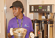 First year H.E.A.R.T. student makes coffee in the Texan Cafe.