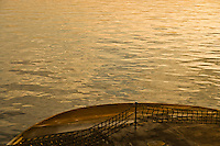 golden evening light on a Washington State Ferry displaying the bow and water