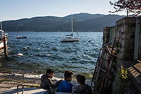 VERBANIA, ITALY - 18 APRIL 2017: Children play by the Lake Maggiore in Verbania, Italy, on April 18th 2017.<br /> <br /> Emma Morano was an Italian supercentenarian who, prior to her death at the age of 117 years and 137 days, was the world's oldest living person whose age had been verified, and the last living person to have been verified as being born in the 1800s. She died on April 15th 2017.