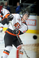 KELOWNA, CANADA, OCTOBER 11: Dylan Bredo #27 of the Medicine Hat Tigers takes a shot on net during warm up  as the Medicine Hat Tigers visited the Kelowna Rockets on October 11, 2011 at Prospera Place in Kelowna, British Columbia, Canada (Photo by Marissa Baecker/shootthebreeze.ca) *** Local Caption ***Dylan Bredo;