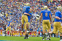 17 October 2012: Quarterback (17) Brett Hundley of the UCLA Bruins is congratulated by teammates after scoring against the USC Trojans during the second half of UCLA's 38-28 victory over USC at the Rose Bowl in Pasadena, CA.