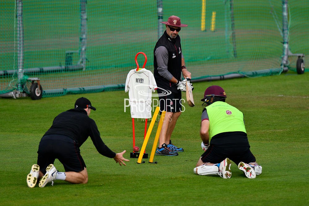 Somerset Director of Cricket Matt Maynard giving slip catching practice to Craig Overton of Somerset during the Specsavers County Champ Div 1 match between Somerset County Cricket Club and Middlesex County Cricket Club at the Cooper Associates County Ground, Taunton, United Kingdom on 28 September 2017. Photo by Graham Hunt.