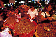In the Abastos market, piles of chapulines, or grasshoppers, for sale among the other fresh produce of the market. Oaxaca, Mexico. (Man Eating Bugs page 112 Bottom)