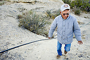 22 OCTOBER 2007 -- COYOTE CANYON, NM: MARK TSOSIE, 78 years old, a member of the Navajo Nation, checks on the piping used in his home made irrigation system in Peach Springs Wash near Coyote Canyon. Tsosie has to haul water from his well to his home and livestock. He has been hauling water all his life. He started working for the railroad when he was 14 years old. His job was to haul water to the workers. Now retired and he's still hauling water except now he hauls it to his home. More than 30 percent of the homes on the Navajo Nation, about the size of West Virginia and the largest Indian reservation in the US, don't have indoor plumbing or a regular supply of domestic water. Many of these homes have to either buy water from commercial vendors or haul water from public wells. A Federal study showed that the total cost of hauling water was about $113 per 1,000 gallons. A Phoenix household, in comparison, pays just $5 a month for up to 7,400 gallons of water. The lack of water on the reservation means the Navajo are among the most miserly users of water in the United States. Families that have to buy or haul water use only about 15 gallons of water per day per person. In Phoenix, by comparison, the average water use is about 170 gallons per day.  Photo by Jack Kurtz/ZUMA Press
