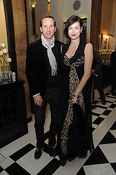 GAWAIN RAINEY and JASMINE GUINNESS at the launch of the Claridge's Christmas Tree designed by John Galliano for Dior held at Claridge's, Brook Street, London on 1st December 2009.