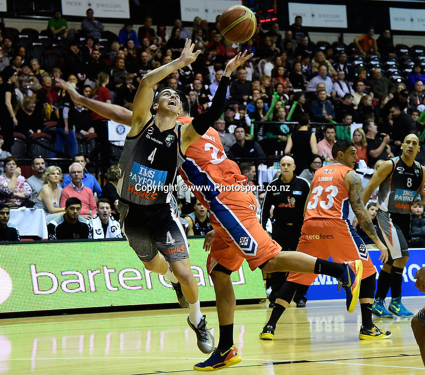 Marco Alexander (L) of the Hawks jumps to shoot with Tai Wesley of the Sharks in defense during a NBL - Hawks vs Sharks semi final four basketball match at the TSB Arena in Wellington on Friday the 4th of July 2014. Photo by Marty Melville/www.Photosport.co.nz