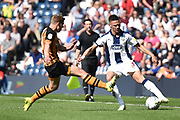 West Bromwich Albion defender Kieran Gibbs (3) looks to evade a tackle during the EFL Sky Bet Championship match between West Bromwich Albion and Hull City at The Hawthorns, West Bromwich, England on 19 April 2019.