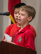 Students comment during the dedication and ribbon cutting for the Mandarin Immersion Magnet School, October 24, 2016.