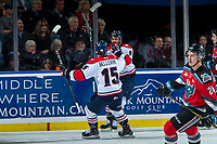 KELOWNA, CANADA - NOVEMBER 17: Jordy Bellerive #15 skates to Giorgio Estephan #9 of the Lethbridge Hurricanes to celebrate a second period goal against the Kelowna Rockets on November 17, 2017 at Prospera Place in Kelowna, British Columbia, Canada.  (Photo by Marissa Baecker/Shoot the Breeze)  *** Local Caption ***