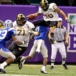 Dec 20, 2009; New Orleans, LA, USA; Southern Miss Golden Eagles running back Damion Fletcher (25) leaps over Middle Tennessee State Blue Raiders cornerback Alex Suber (7) during the second half of the 2009 New Orleans Bowl at the Louisiana Superdome. Middle Tennessee State defeated Southern Miss 42-32. Mandatory Credit: Derick E. Hingle-US PRESSWIRE